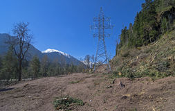 Transmission line under construction in mountains. Stock Image