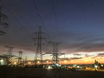 Transmission lines and electro wires at sunset royalty free stock images