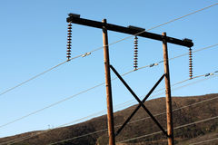 Transmission lines & telephone poles. Close view of the top of transmission lines on telephone poles; 69 Kv Royalty Free Stock Photos