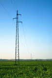 Transmission poles at field Royalty Free Stock Photos