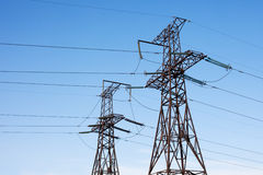 Transmission power line. On blue sky background Royalty Free Stock Photography