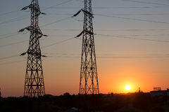 Transmission power line silhouette on sunset Royalty Free Stock Image