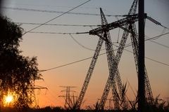 Transmission power line silhouette on sunset. High voltage transmission power line silhouette on sunset Stock Photo