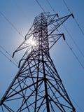 Transmission Pylon and Sun Stock Photos
