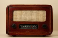 Vintage radio on cream background stock photos