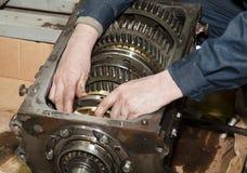 Transmission repair close up. Worker repairs transmission close up Stock Photos