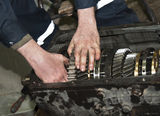 Transmission repair close up. Worker repairs transmission close up Royalty Free Stock Images
