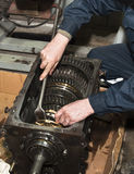 Transmission repair close up. Worker repairs transmission close up Stock Photo