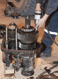 Transmission repair. Mechanic working on a broken vehicle, transmission repair Stock Photo
