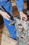 Transmission repair. Mechanic working on a broken vehicle, transmission repair Royalty Free Stock Photos