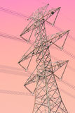 Transmission tower. With red toned royalty free stock photo