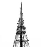Transmission tower. Telecomms tower/mast, isolated on white ground; good copy-space Stock Image