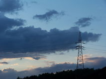 Transmission tower. Against beautiful cloudy sky royalty free stock photo