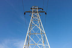 Transmission Tower Against Blue Sky. Tall Steel Transmission Tower Against Blue Sky stock photography