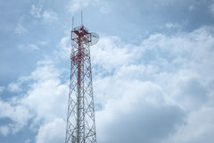 Transmission tower against  sky and clouds Stock Photos