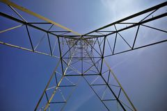 Transmission tower architecture. A distinctive perspective on a transmission tower from underneath that shows the intricate geometric shapes in its design stock photos