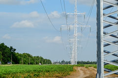 Transmission tower on a background field of soybeans.  royalty free stock photos