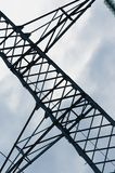 Transmission tower on cloudy background sky. Closeup of transmission tower on cloudy background sky. Electricity, electric power, overhead power line and stock image