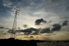 Transmission Tower. With Cloudy Sky and Backlight royalty free stock images