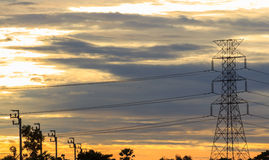 Transmission tower at early morning. Silhouette Transmission tower at early morning stock images