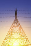 Transmission tower. Electrical transmission tower with blue sky background royalty free stock photo