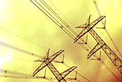 Transmission Tower. Electrical Transmission towers and power lines with a yellow sky background royalty free stock photos