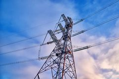 A transmission tower or electricity pylon with blue sky. It is a tall structure, usually a steel lattice tower, used to support an. Overhead power line. Moscow stock image