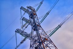 A transmission tower or electricity pylon with blue sky. It is a tall structure, usually a steel lattice tower, used to support an. Overhead power line. Moscow stock photo