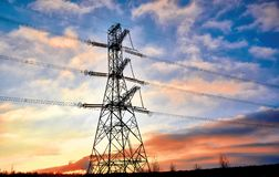 A transmission tower or electricity pylon with blue sky. It is a tall structure, usually a steel lattice tower, used to support an. Overhead power line. Moscow royalty free stock image