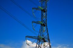 A transmission tower or electricity pylon with blue sky. It is a tall structure, usually a steel lattice tower, used to support an. Overhead power line. Moscow stock images