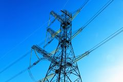 A transmission tower or electricity pylon with blue sky. It is a tall structure, usually a steel lattice tower, used to support an. Overhead power line. Moscow royalty free stock photography
