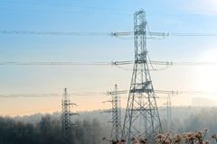 A transmission tower or electricity pylon with blue sky. It is a tall structure, usually a steel lattice tower, used to support an. Overhead power line. Moscow stock photos