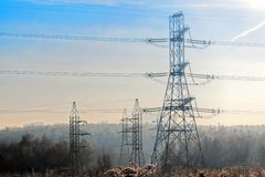 A transmission tower or electricity pylon with blue sky. It is a tall structure, usually a steel lattice tower, used to support an. Overhead power line. Moscow royalty free stock photos