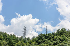 Transmission tower and forest Royalty Free Stock Photography