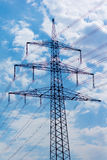 Transmission tower. In front of a blue sky with some clouds stock photography