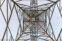 Transmission tower viewed from the bottom. Transmission tower in front of a couldy sky stock images