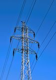 Transmission tower. High voltage transmission tower in blue sky stock photo