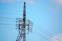 Transmission tower with high voltage wires on the side. Transmission tower with high voltage wires stock photography