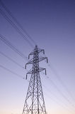 Transmission tower. An isolated electricity transmission tower Royalty Free Stock Photos