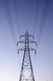 Transmission tower. An isolated electricity transmission tower Royalty Free Stock Images