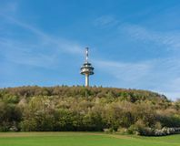 Transmission tower on the Koeterberg mount against sky, Germany.  royalty free stock photography