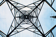 Transmission tower. Looking upwards at the base a transmission tower with a light blue sky background royalty free stock photos