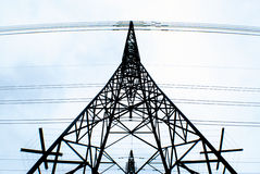 Transmission tower. Looking upwards at a transmission tower with a light blue sky background stock photo