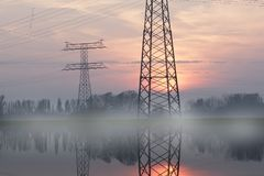 Transmission Tower, Overhead Power Line, Reflection, Sky Stock Photo