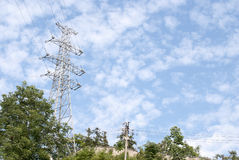 Transmission tower. Power transmission tower against the blue sky background stock image