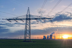 Transmission tower, power tower power plant. Sunset with transmission tower and power plant royalty free stock image