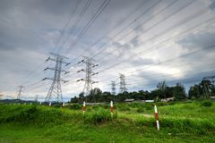 Transmission tower or power tower. A transmission tower or power tower electricity pylon in the United Kingdom, Canada and parts of Europe is a tall structure stock photo