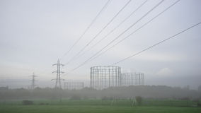 Transmission tower, pylon,. In the foggy countryside royalty free stock image