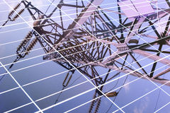 Transmission tower reflected in solar panel Stock Images