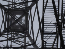 Transmission tower silhouette in deep mist white background Royalty Free Stock Image